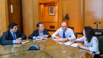 Guzmán se reunió con misión del FMI, que calificó encuentros de